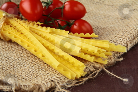 Italian pasta on a wooden board wish tomato