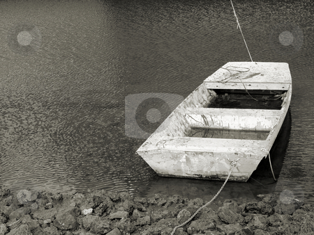 On the shores stock photo, Old boat along the shore in very poor condition shown in black and white by Tim Markley