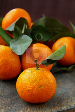 Fresh mandarin orange with green leaves stock photo,  by Olga Kriger
