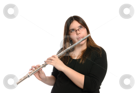 Girl Playing Flute stock photo, A young brunette girl is playing the flute, isolated against a white background. by Richard Nelson