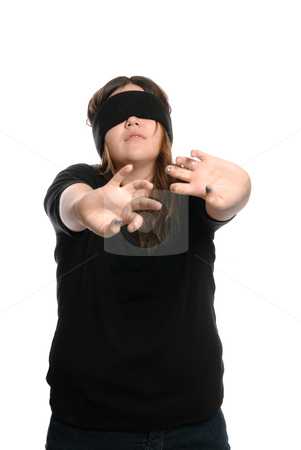 Blindfolded Teen stock photo, Concept image of a young girl walking blind or lost and feeling her way around with her arms outstretched, isolated against a white background. by Richard Nelson