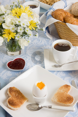 Romantic breakfast stock photo, Valentine breakfast with heart shaped toast and eggs by Anneke