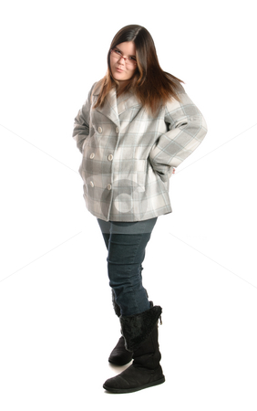 Teenage Girl With Attitude stock photo, Full length view of a teenage girl posing and showing attitude, isolated against a white background by Richard Nelson