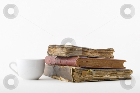 Coffee cup and three old book stock photo, Coffee cup and three old book on white background by Victor Oancea
