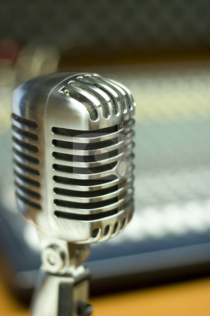 Vintage Microphone in music studio stock photo, Front view of vintage microphone in music studio by caimacanul