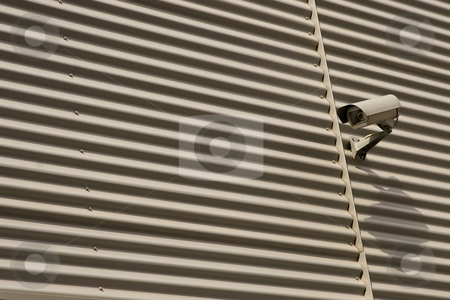 Big brother stock photo, Detail of surveillance camera mounted on metal facade by caimacanul
