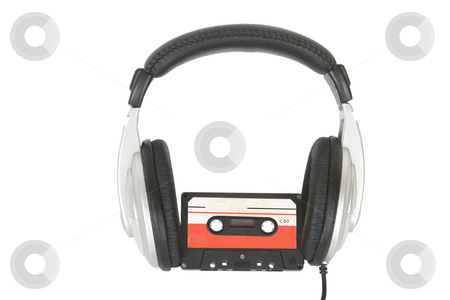 Dj headphones and audio cassette stock photo, Front view of dj headphones and audio cassette by Victor Oancea
