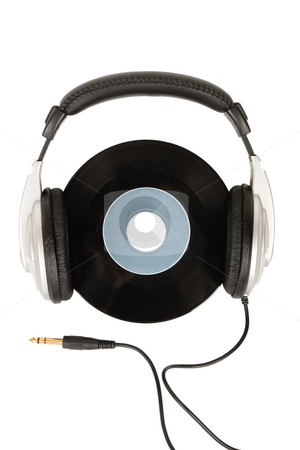 Dj headphones and vintage vinyl stock photo, Front view of dj headphones and vintage vinyl by Victor Oancea