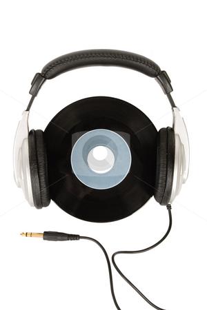 Dj headphones and vintage vinyl stock photo, Front view of dj headphones and vintage vinyl by caimacanul