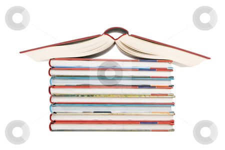 Color tower books arranged in house shape stock photo, Color tower books on white background arranged in house shape by Victor Oancea