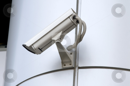 Surveillance camera stock photo, Detail of surveillance camera mounted on metal facade by Victor Oancea