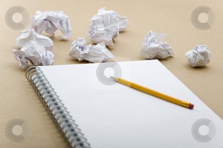 Crumpled paper and yellow pencil stock photo, Crumpled paper and crushed yellow pencil on notebook by Victor Oancea