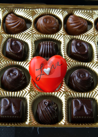 Chocolate with a red heart on Valentine's Day stock photo,  by Olga Kriger