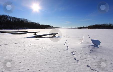 Winter scene stock photo, Empty dock in frozen lake in the winter time by Sreedhar Yedlapati