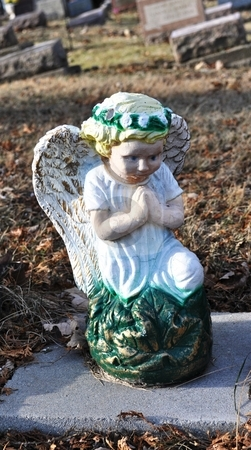 Gravesite - Angel - Blue Eyes stock photo, Gravesite - Angel - Blue Eyes by Liane Harrold