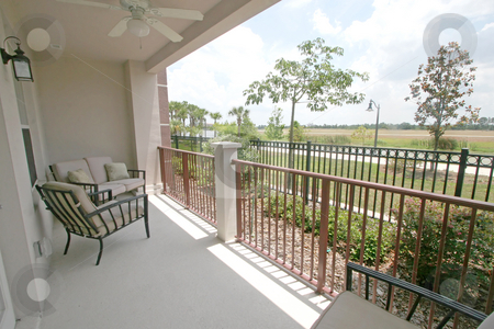 Patio stock photo, A Patio of a ground floor condo overlooking a river by Lucy Clark