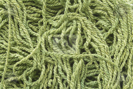 Woolen yarn stock photo, Background with green woolen yarn by Olena Pupirina