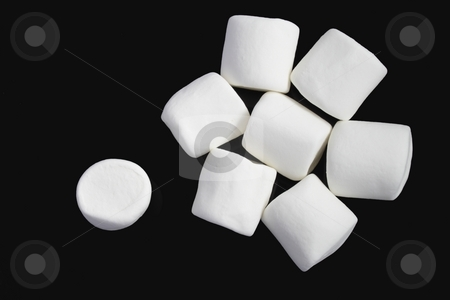 Marshmallows stock photo, Group of white marshmallows on black background by Olena Pupirina