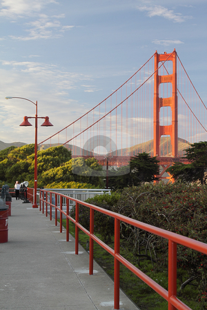 Golden Gate Bridge stock photo, View on the Golden Gate Bridge from a sidewalk by Olena Pupirina