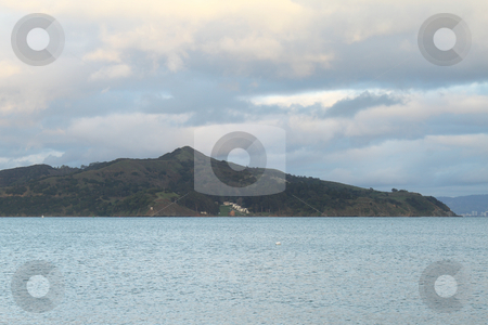 Seascape stock photo, Seascape with Angel island on the horizon on a cloudy evening by Olena Pupirina