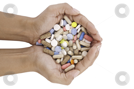 Pills in hands stock photo, Pills in hands isolated on white background by caimacanul