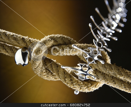 Knotted rope jewelry stock photo, Two ropes form a clapse for jewelry by Luca Mosconi