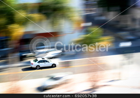Car In Motion stock photo, View of a car moving in the street below. by Henrik Lehnerer