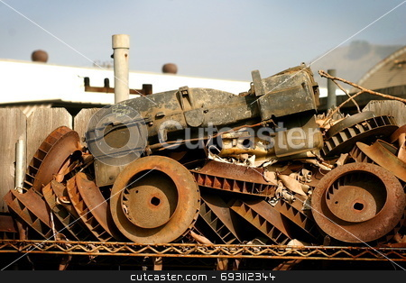 Rusty Tractor stock photo, Some junk in a junk yard when viewing from the right angle builds an old tractor. by Henrik Lehnerer