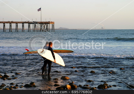 Surfer at Sunset stock photo, Surfer at sunset at the beach near the pier in Ventura California. by Henrik Lehnerer
