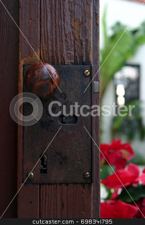 Door stock photo, A doorknob a the mission San Bueanaventura in Ventura California by Henrik Lehnerer