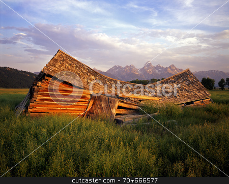 Falling Down Barn stock photo, An old barn in Grand Teton National Park, Wyoming. by Mike Norton