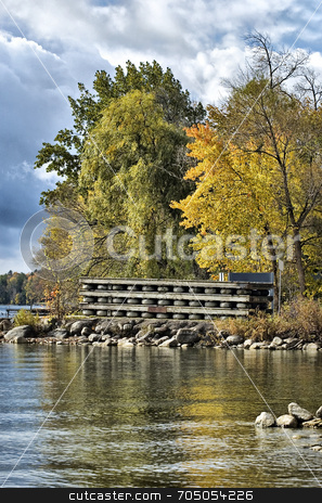 Autumn Lake View stock photo, An HDR image of a lakeshore in early autumn, piled with docks in preparation for winter. by J. Gracey Stinson