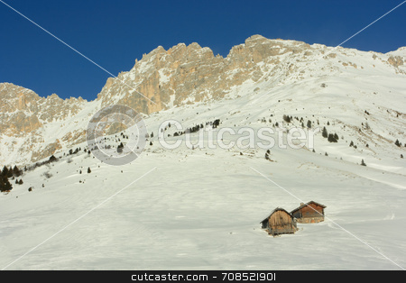 Alpine huts stock photo, Alpine huts near rocky mountain covered with snow by Natalia Macheda