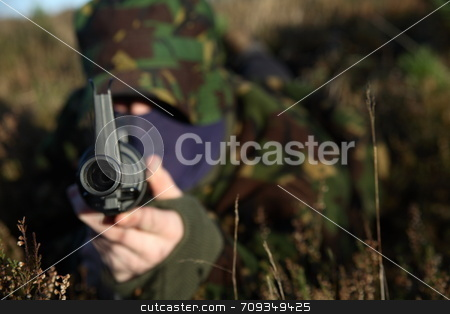 Soldier and his Rifle stock photo, A soldier on the floor pointing his rifle at you! by Daniel Wiedemann