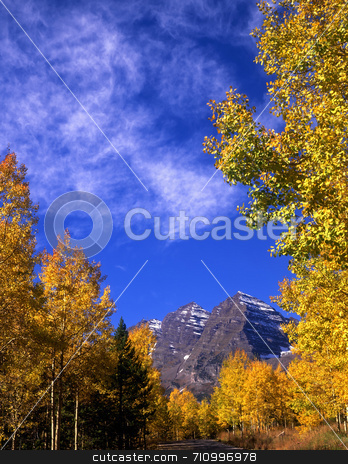 Maroon Bells Vertical stock photo, The Maroon Bells in the White River National Forest of Colorado. by Mike Norton