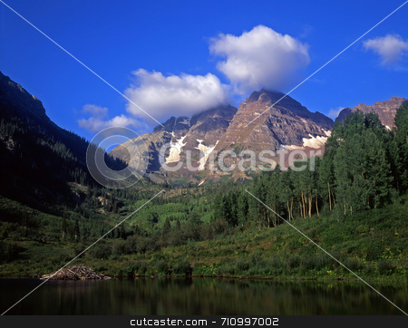 Maroon Bells Summer Clouds stock photo, The maroon Bells in the White River National Forest of Colorado. by Mike Norton