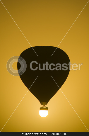 Landing on the Sun stock photo, A Hot Air Balloon perfectly aligned with the sun. by Daniel Wiedemann