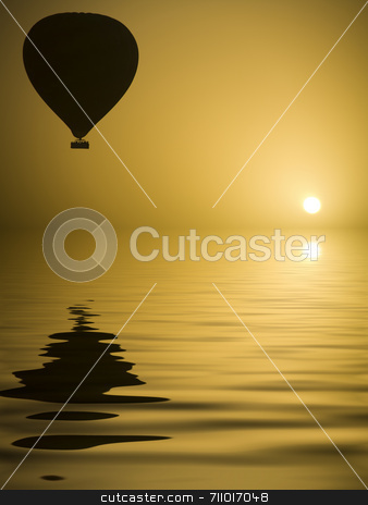 Hot Air Balloon and the Sun stock photo, A hot air Balloon backlit by the rays of the morning Sun.  (with water reflection) by Daniel Wiedemann