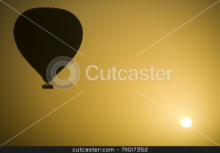 Hot Air Balloon and the Sun stock photo, A hot air Balloon backlit by the rays of the morning Sun. by Daniel Wiedemann