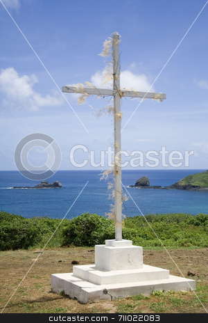 Religious Cross stock photo, A simple white, wooden cross with the great blue ocean in the background! by Daniel Wiedemann