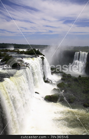 Iguassu waterfall, Iguazu waterfall stock photo, The Iguassu (or Iguazu) Falls is one of the largest masses of fresh water on the planet and divides, in South America, Brazil, Paraguay and Argentina. The waterfall system consists of 275 falls along 2.7 kilometres (1.67 miles) of the Iguazu River. Some of the individual falls are up to 82 metres (269 feet) in height, though the majority are about 64 metres (210 feet). by Daniel Wiedemann