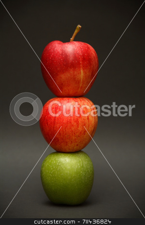 Apple Exception stock photo, A line of apples with one exception. by Daniel Wiedemann