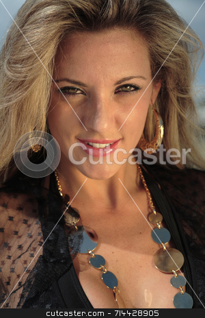 Female portrait stock photo, Closeup of A blonde, 20-30 year old female model on the beach, in Florian???polis - Brazil. This is part of a series. Have a look at the other photos of this model in various outfits and poses. by Daniel Wiedemann