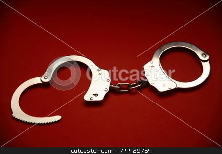 Handcuffs stock photo, A pair of open handcuffs. by Daniel Wiedemann