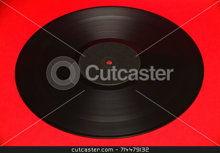 Gramophone Record stock photo, A gramophone record isolated on a red background. by Daniel Wiedemann