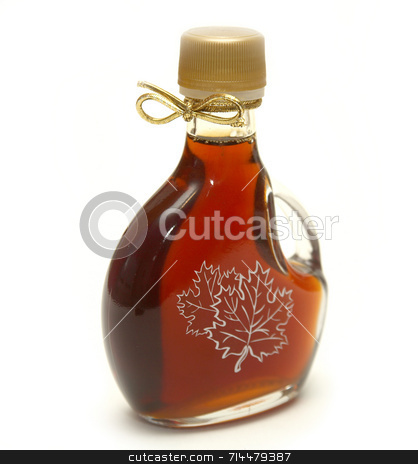 Maple Syrup stock photo, A small bottle of maple syrup with the maple leaves printed on the front and a nice golden ribbon on the neck! by Daniel Wiedemann