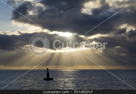 Rays of Light stock photo, A gorgeous scene of rays of light on the horizon. by Daniel Wiedemann