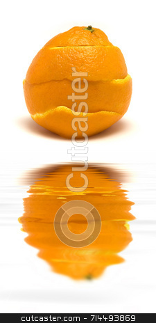 Healed stock photo, An orange peal being healed.   (with water reflection) by Daniel Wiedemann