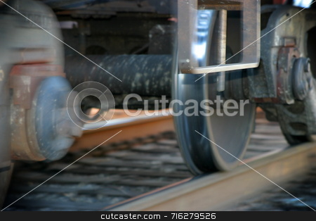 Train Tires stock photo, Photo of a moving train with part of the photo blurred to show the movement by Henrik Lehnerer