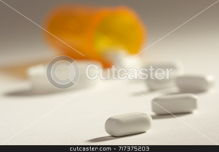 Pills and Fallen Bottle stock photo, Pills and Fallen Bottle with Dramatic Lighting. by Andy Dean